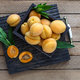 Delicious ripe apricots in a wooden box on the table. copyspace - PhotoDune Item for Sale