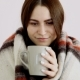 Beautiful Happy Girl of European Appearance in a Woolen Blanket Is Drinking Hot Tea - VideoHive Item for Sale