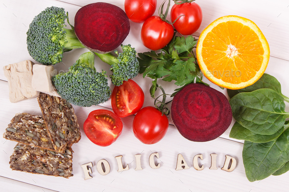 Inscription folic acid with nutritious ingredients containing vitamin B9, natural minerals - Stock Photo - Images