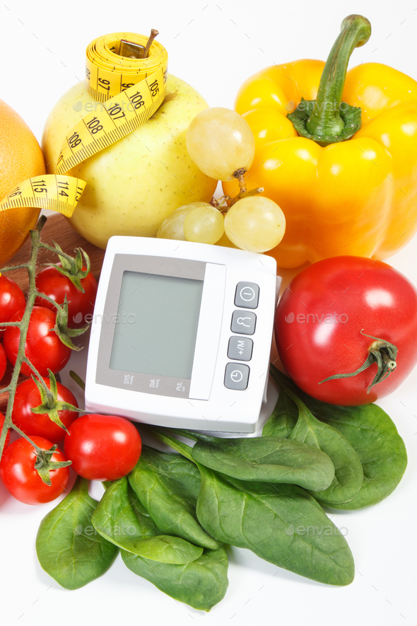 Blood pressure monitor, fruits with vegetables and centimeter, prevention of hypertension concept - Stock Photo - Images