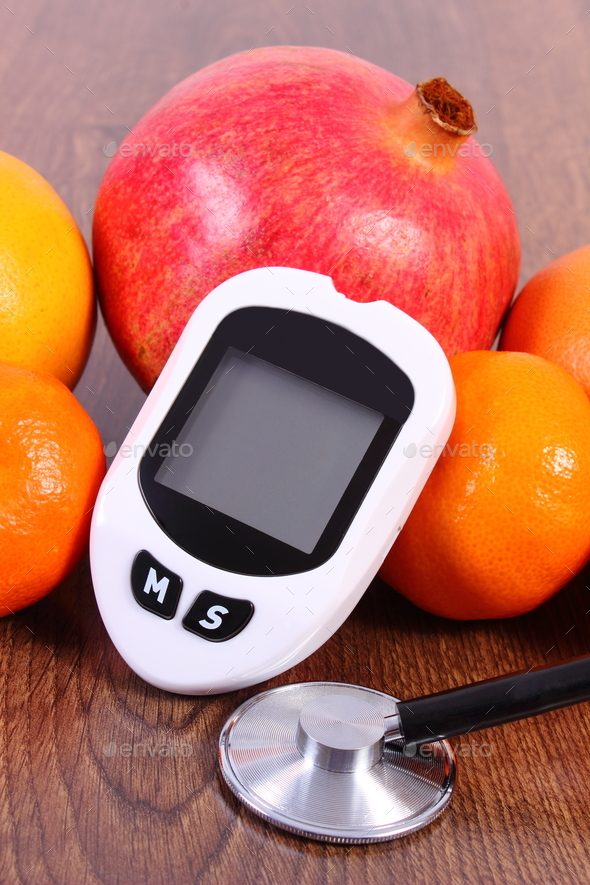 Glucometer for checking sugar level, stethoscope and fresh fruits - Stock Photo - Images