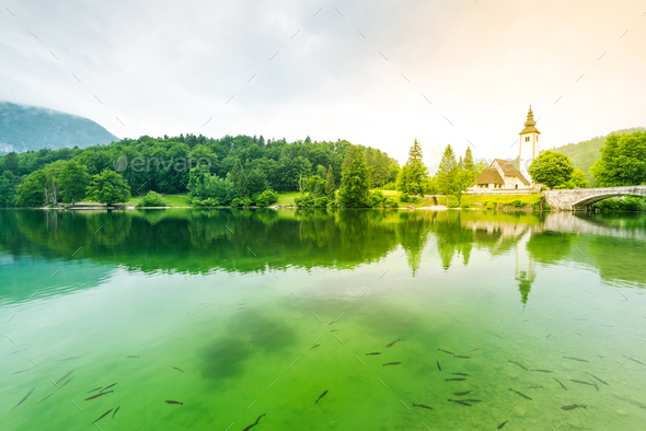 Cristal clear water and Church of Sv. John the Baptist  by the B - Stock Photo - Images