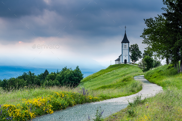 Beautiful sunrise at Church of St. Primus and Felician, Jamnik, - Stock Photo - Images