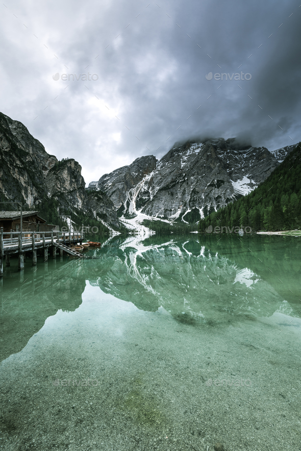 Moody image of Pragser Wildsee or Braies Lake in Italy. - Stock Photo - Images