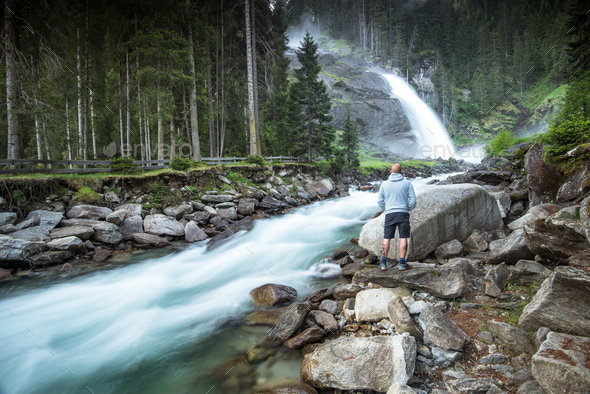 Man standing at Krimml Waterfalls in High Tauern National Park A - Stock Photo - Images
