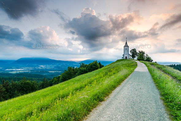 Romantic village, Church of St. Primus and Felician, Jamnik, Slo - Stock Photo - Images