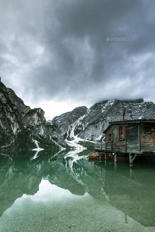 Moody image of Pragser Wildsee or Braies Lake in Italy. - Stock Photo - Images