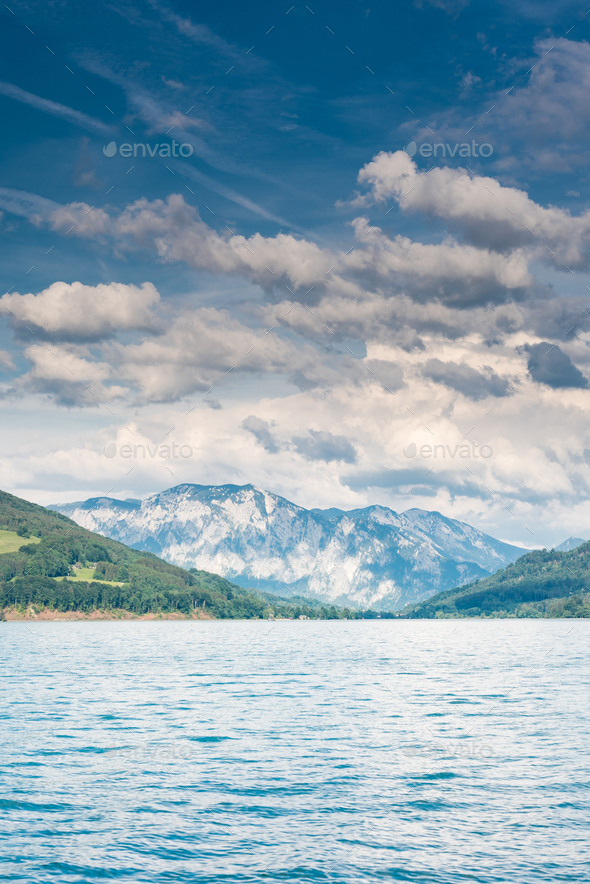 Beautiful cloudscape over mountains and lake at Wolfgangsee,Aust - Stock Photo - Images