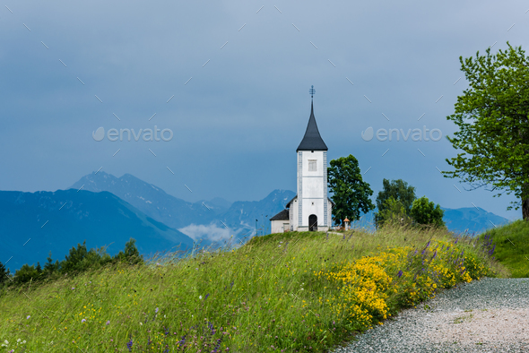 Church of St. Primus and Felician, Jamnik Slovenia at stormy wea - Stock Photo - Images