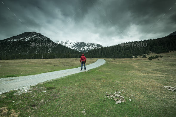 Man standing in front of mountains,moody concept - Stock Photo - Images