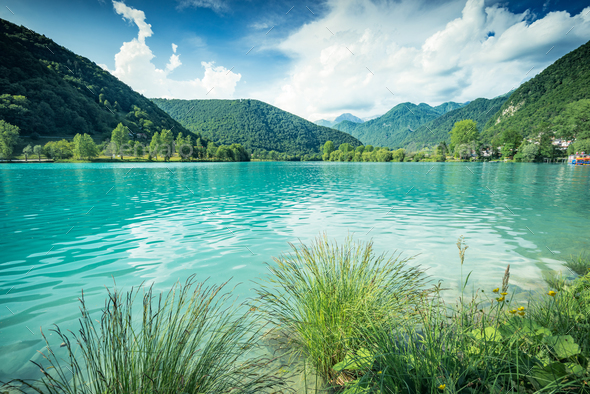Emerald green water at Most na Soci Lake in Slovenia - Stock Photo - Images