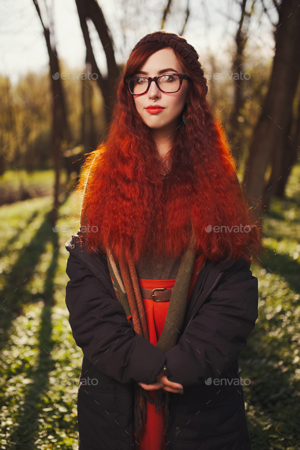 red haired girl in the forest - Stock Photo - Images
