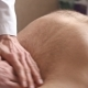 Massagist Making Abdominal Massage for Man in the Clinic - VideoHive Item for Sale