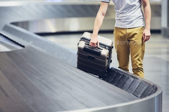 Suitcase on baggage claim - Stock Photo - Images
