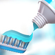 Toothbrush and tube of toothpaste. - PhotoDune Item for Sale