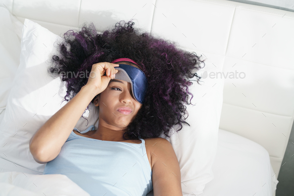 Tired Black Girl Waking Up In Bed With Sleep Mask - Stock Photo - Images