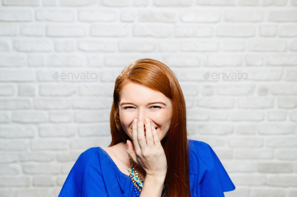 Facial Expressions Of Young Redhead Woman On Brick Wall - Stock Photo - Images