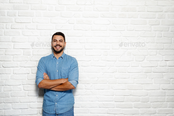 Facial Expressions Of Young Beard Man On Brick Wall - Stock Photo - Images