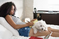 Girl Studying For School Homework With Dog On Legs - PhotoDune Item for Sale