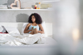 Woman Drinking Coffee Watching Movie In Bed on Sunday - PhotoDune Item for Sale