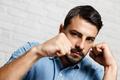 Facial Expressions Of Young Beard Man On Brick Wall
