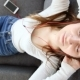 Beautiful Girl Listens To Music with Mobile Phone in Headphones on Sofa at Home - VideoHive Item for Sale