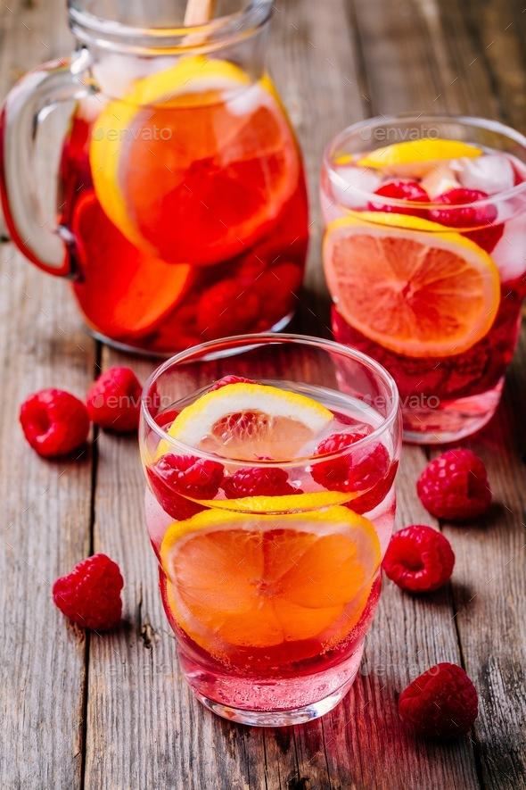 Sparkling Lemon Raspberry Lemonade Sangria in glass on wooden background - Stock Photo - Images