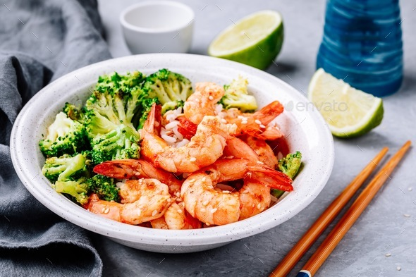 Spicy Shrimp Burrito Bowl with cilantro lime rice and broccoli - Stock Photo - Images