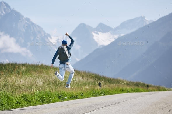 Happy traveler in mountains - Stock Photo - Images