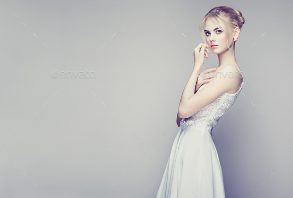 Fashion portrait of beautiful young woman with blond hair - Stock Photo - Images