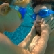 Underwater Shot of Father and His Toddler Son Swining Diving and Having Fun in a Pool - VideoHive Item for Sale