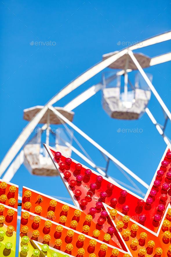 Amusement park details against the blue sky. - Stock Photo - Images