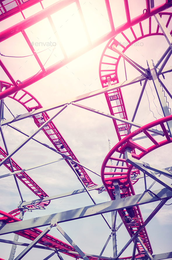 Roller coaster tracks in an amusement park at sunset. - Stock Photo - Images