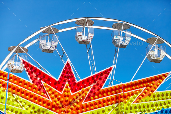Ferris wheel in an amusement park. - Stock Photo - Images