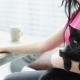 Life with Pets. Beautiful Girl Is Working at Home on a Laptop with a Black Cat on Her Hands. - VideoHive Item for Sale