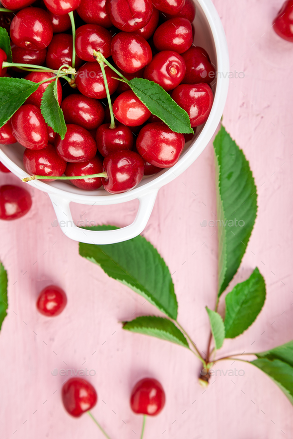 Red cherry in white bowl - Stock Photo - Images