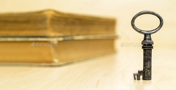 Key and old books - Stock Photo - Images