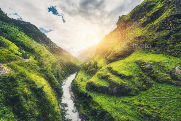 Amazing mountains covered green grass, river at sunset - Stock Photo - Images