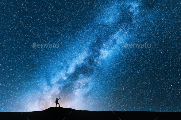 Man with trekking poles and sky with Milky Way - Stock Photo - Images