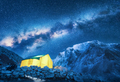 Milky Way, yellow glowing tent and mountains. Space - PhotoDune Item for Sale