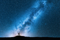 Man with trekking poles and sky with Milky Way - PhotoDune Item for Sale
