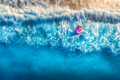 Aerial view of young woman swimming on the pink swim ring - PhotoDune Item for Sale