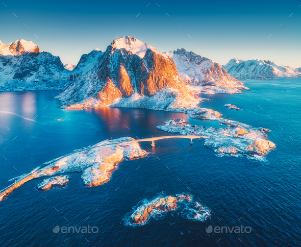 Aerial view of Reine and Hamnoy at sunrise in winter - Stock Photo - Images