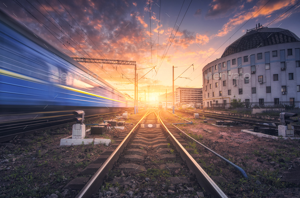 Railway station with blurred modern passenger train - Stock Photo - Images