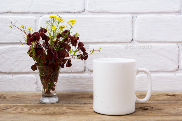 White coffee mug mockup with maroon and yellow grass - Stock Photo - Images