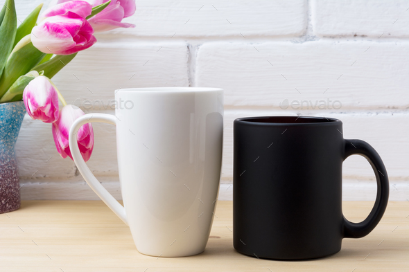 Black coffee cup and white cappuccino mug mockup with magenta tu - Stock Photo - Images