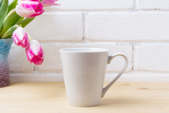 White latte mug mockup with magenta tulip - Stock Photo - Images