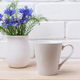 White coffee latte mug mockup with cornflower in rustic vase - PhotoDune Item for Sale