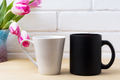 Black coffee cup and white latte mug mockup with magenta tulip - PhotoDune Item for Sale