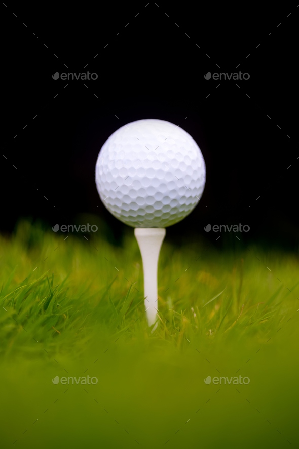 Golf ball on tee - Stock Photo - Images